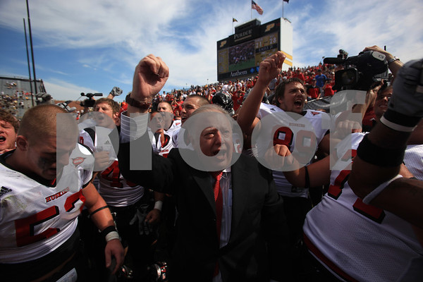 Beck Diefenbach – bdiefenbach@daily-chronicle.com<br /> <br /> Northern Illinois President John Peters  leads the Huskies in celebrating the defeat of Purdue University in West Lafayette, Ind., on Saturday Sept. 19, 2009