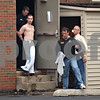Beck Diefenbach  -  bdiefenbach@daily-chronicle.com<br /> <br /> A man is lead away by police from an apartment building on the 800 block of Kimberly Drive following an early morning stand off with police in DeKalb, Illl., on Wednesday May 27, 2009.