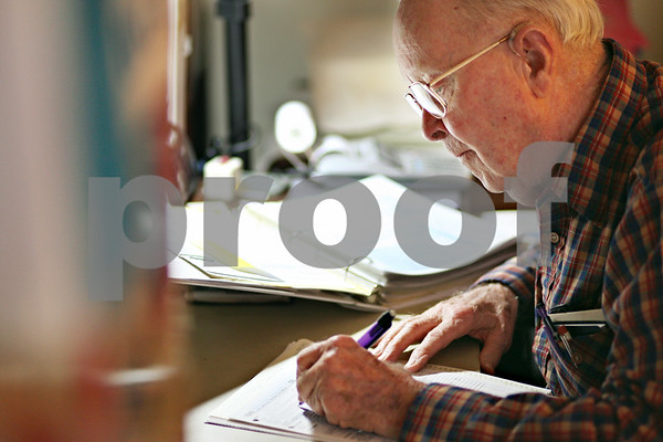 Beck Diefenbach  -  bdiefenbach@daily-chronicle.com<br /> <br /> Don Mosher, who lived through the Great Depression, works on his taxes in his home at Oak Crest Retirement home in DeKalb, Ill., on Tuesday Feb. 10, 2009.
