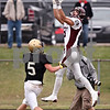 Beck Diefenbach  -  bdiefenbach@daily-chronicle.com<br /> <br /> Montini wide receiver Jordan Westerkamp (81, right) completes a pass above Sycamore defensive back Eric Ray (5) during the second quarter of the playoff game at Sycamore High School in Sycamore, Ill., on Saturday Nov. 14, 2009.