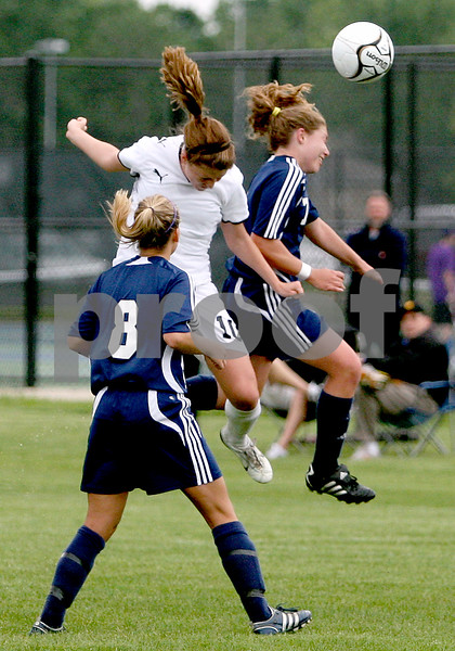 Rob Winner – rwinner@daily-chronicle.com<br /> Karissa Miller (10) knocks in a header for a goal with an assist from Brian Henke (not pictured) in the first half. Sycamore defeated Peoria Notre Dame, 5-0, during the Class 2A Rochelle Supersectional on Tuesday.<br /> 06/02/2009