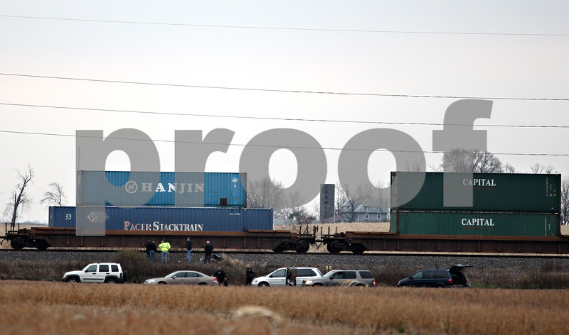 Beck Diefenbach  -  bdiefenbach@daily-chronicle.com<br /> <br /> Vehicles and personnel stand by a train parked near Nelson Road and south of Route 38 on Wednesday Nov. 4, 2009.