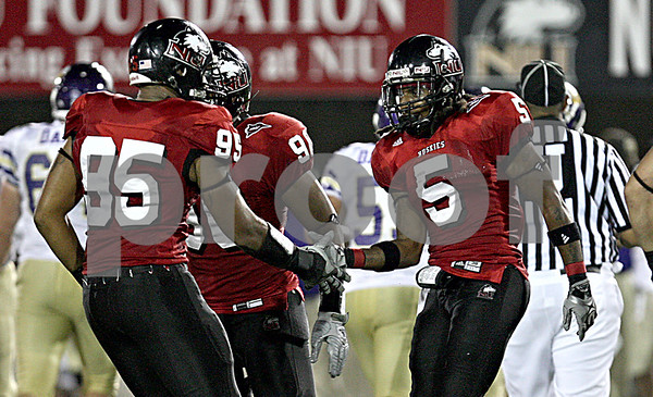 Rob Winner –  rwinner@daily-chronicle.com<br /> Chris Smith (5) celebrates with his teammates after a defensive stop in the second half of Saturday night's game against Western.<br /> 09/12/2009