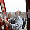 Beck Diefenbach – bdiefenbach@daily-chronicle.com<br /> <br /> DeKalb High School senior Jordan Sopko, right, gets help from class instructor Steve Johnson, left, on how to raise a ladder of the project house in Sycamore, Ill., built in the construction trades class through the Kishwaukee Education Consortium on Tuesday March 10, 2009.