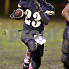 Beck Diefenbach  -  bdiefenbach@daily-chronicle.com<br /> <br /> Hiawatha defensive back Carton Puckett (23) runs for a touchdown after intercepting the ball from North Shore Country Day School during the first quarter of the game at Hiawatha High School in Kirkland, Ill., on Friday Oct. 23, 2009.