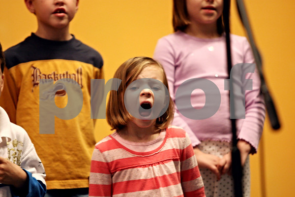 Rob Winner – rwinner@daily-chronicle.com<br /> Waterman Elementary kindergarten student Caitlyn Downing, 6, sings with her classmates during a rehearsal for a holiday pageant at Indian Creek High School in Shabbona, ILL. on Tuesday December 8, 2009.