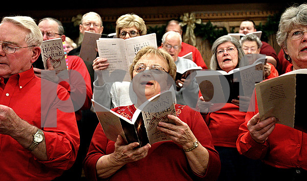 Rob Winner – rwinner@daily-chronicle.com<br /> Members of the Celebration Chorale, including June Cribaro, practice on Wednesday November 25, 2009 at the First United Methodist Church of DeKalb. Founded in 1994, the Celebration Chorale is an ecumenical choir made up of singers from several area churches and religious backgrounds.<br /> 11/25/2009
