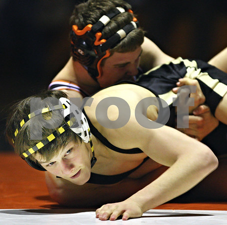Beck Diefenbach  -  bdiefenbach@daily-chronicle.com<br /> <br /> DeKalb's Tyler Larson takes control of Sycamore's Zach Spiewak during the 119 weight class match at DeKalb High School in DeKalb, Ill., on Thursday Jan. 22, 2009.