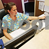 Beck Diefenbach  -  bdiefenbach@daily-chronicle.com<br /> <br /> Receptionist Heather Vonbergen scans in a patient's medical information which is then digitally absorbed into their medical record at AIM Immediate Care in Sycamore, Ill., on Tuesday July 14, 2009