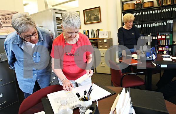 Beck Diefenbach  -  bdiefenbach@daily-chronicle.com<br /> <br /> Volunteer Jane Malmborg (left) and county historian Phyllis Kelley (center) review a document while researching the early Sycamore settler Lysander Darling for Martha Waymire (right), of Bella Vista, Ark., at the Joiner History Room in the Sycamore library in Sycamore , Ill., on Thursday April 30, 2009.  Waymire's son now lives on Darling Court in Sycamore and was curious about the origin of the street's name.