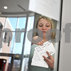 Beck Diefenbach  -  bdiefenbach@daily-chronicle.com<br /> <br /> Northern Illinois University senior Kim Nelson posts index cards with statements describing acts of kindness on the window of the NIU honors program office in the Campus Life building in DeKalb, Ill., on Friday Feb. 6, 2009. The index cards, part of Huskie Acts of Kindness, were written by local elementary and high school students who were asked to do an act of kindness in preparation for the anniversary of the Feb. 14th shootings.