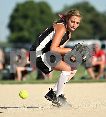 Beck Diefenbach  -  bdiefenbach@daily-chronicle.com<br /> <br /> Kishwaukee Valley Storm Klein Natalie (83) misses a ground ball during a 14-under game against the Schaumburg Sluggers during Storm Dayz in Sycamore, Ill., on Friday June 26, 2009.