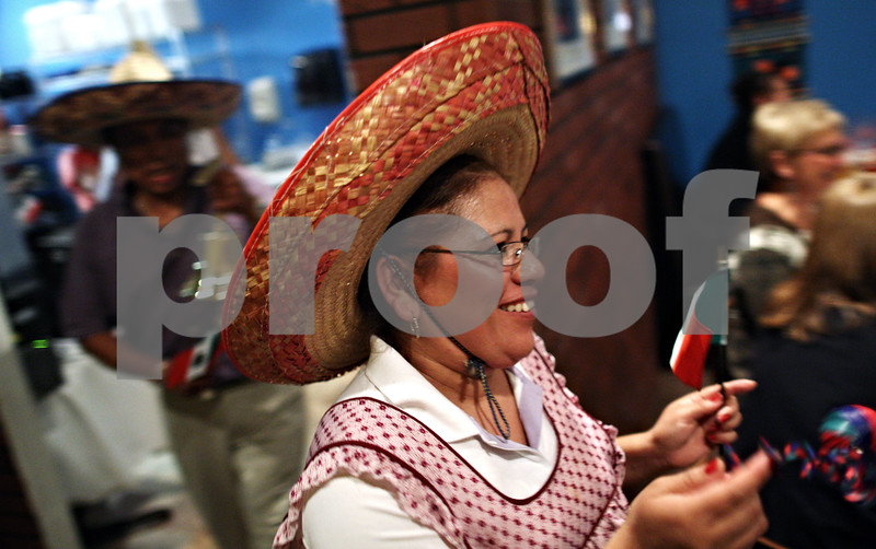 Beck Diefenbach  -  bdiefenbach@daily-chronicle.com<br /> <br /> Irma Garcia rushes through Taxco Restaurant in Sycamore, Ill. in celebration of Mexican Independence Day and Mexican Heritage Month on Wednesday Sept. 17, 2009.