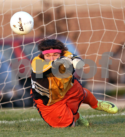 Beck Diefenbach  -  bdiefenbach@daily-chronicle.com<br /> <br /> Genoa-Kingston's goal keeper Taylor Rogers (left) blocks a shot by Northridge during second half of the regional playoff game at GK High School in Genoa, Ill., on Tuesday Oct. 13, 2009. After two overtime periods, the game was suspended due to darkness and will be restarted on Thursday at 4:30 P.M. at Genoa-Kington High School.