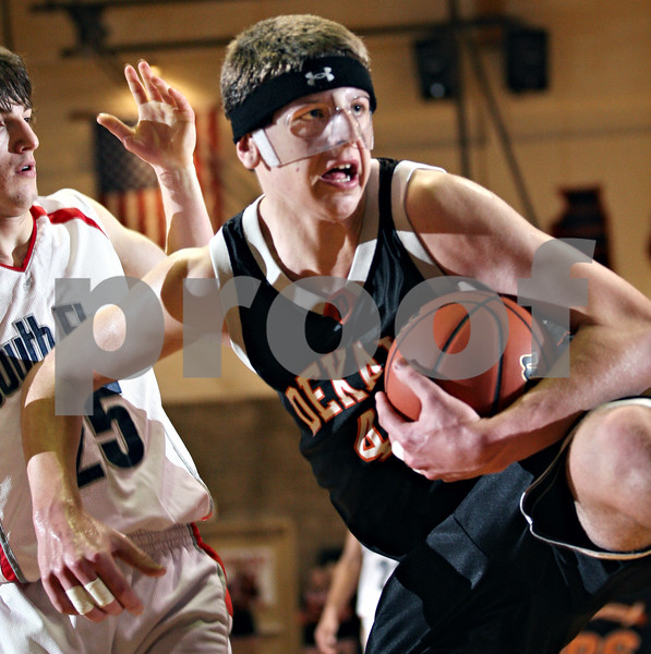 Beck Diefenbach – bdiefenbach@daily-chronicle.com<br /> <br /> DeKalb center Jordan Threloff (42) keeps a rebound away from South Elgin guard Erik Stade (25) during the fourth quarter of the Class 4A regional semi-final game at DeKalb High School in DeKalb, Ill., on Wednesday March 4, 2009.