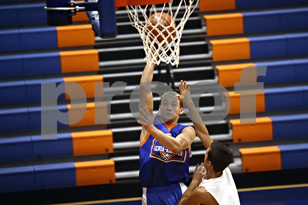 Beck Diefenbach  -  bdiefenbach@daily-chronicle.com<br /> <br /> Genoa's Nick Lopez shoots the ball during practice at Genoa Kingston High School in Genoa, Ill., on Wednesday Jan. 7, 2009.