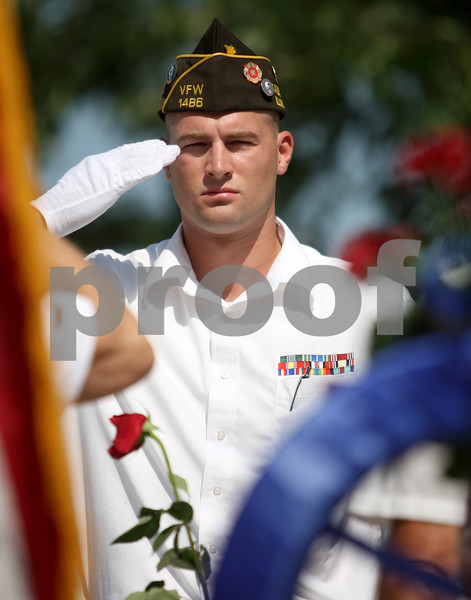 Rob Winner rwinner@daily-chronicle.com<br /> Mike Jones, of VFW Post 1486, stands at attention during a ceremony to remember September 11, 2001 at the Sandwich Fair on Friday afternoon.<br /> 09/11/2009
