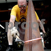 Rob Winner – rwinner@daily-chronicle.com<br /> Chris Hubbard uses a cone mandrel to shape a piece of steel while working in his garage on Tuesday afternoon. Pieces of Hubbard's work can be purchased at the Ellwood House and Museum art show this Sunday.<br /> 06/30/2009