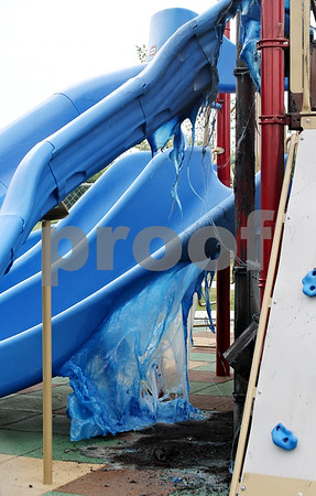 Beck Diefenbach  -  bdiefenbach@daily-chronicle.com<br /> <br /> Melted plastic hangs from a slide at a playground near the corner of Main Street and Mt. Hunger Road in Sycamore, Ill., on Tuesday May 21. 2009.