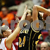 Beck Diefenbach  I  bdiefenbach@daily-chronicle.com<br /> <br /> DeKalb guard Kaylyn Smith (13) gets in close to Sycamore guard Sara Cervenka(24) during the fourth quarter of the game at the Northern Illinois University Convocation Center in DeKalb, Ill., on Friday Jan. 30, 2009.