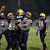 Rob Winner – rwinner@daily-chronicle.com<br /> Teammates gather around Richard Shipley (7) after a defensive stop in the first half as Hiawatha hosted Luther High School North on Friday night.<br /> 10/02/2009