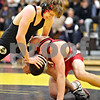 Beck Diefenbach  -  bdiefenbach@daily-chronicle.com<br /> <br /> Sycamore's Shane Lay, top, holds down Yorkville's A.J. Messenger during the 152 lbs match of the game at Sycamore, Ill., on Thursday Dec. 3, 2009.