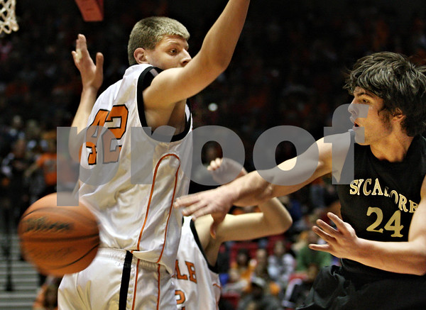 Beck Diefenbach  I  bdiefenbach@daily-chronicle.com<br /> <br /> Sycamore's Harlan Johnson (24) slips a pass by DeKalb's Jordan Threoff (42)during the first quarter of the game at the Northern Illinois University Convocation Center in DeKalb, Ill., on Friday Jan. 30, 2009.