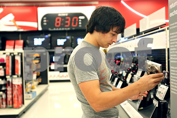 Beck Diefenbach  -  bdiefenbach@daily-chronicle.com<br /> <br /> Tyler Johnson, of Sycamore, checks out cameras while shopping in the rebuilt Target Store in DeKalb, Ill., on Tuesday Oct. 6, 2009.