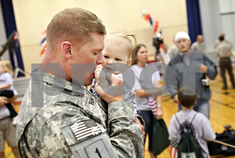 Beck Diefenbach  -  bdiefenbach@daily-chronicle.com<br /> <br /> Mitch Buh kisses his 1 year old daughter Cheyenne after returning from a tour in Afghanistan at the Sycamore National Guard Armory in Sycamore, Ill., on Monday June 1, 2009. Buh was able to come home for Cheyenne's birth but hadn't see her since.