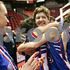 Beck Diefenbach – bdiefenbach@daily-chronicle.com<br /> <br /> Hinckley-Big Rock's Tess Godhart, center right, embraces Kaitlin Phillips after defeating West Central High School for the Class 1A State Championship at the Red Bird Arena in Normal, Ill., on Saturday Feb. 28, 2009.