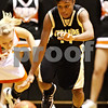 Beck Diefenbach  -  bdiefenbach@daily-chronicle.com<br /> <br /> Sycamore's Lake Kwaza (11) rushes after a loose ball during the fourth quarter of the game against DeKalb at DeKalb High School in DeKalb, Ill., on Tuesday Dec. 1, 2009. Sycamore defeated DeKalb 38 to 33.