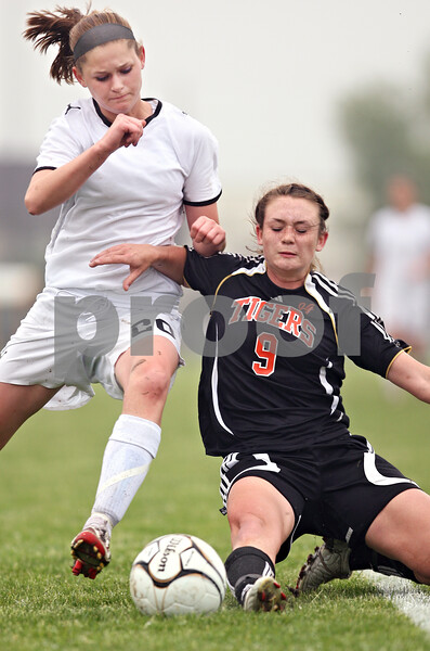 Beck Diefenbach  -  bdiefenbach@daily-chronicle.com<br /> <br /> Crystal Lake Central's Alexa Adams (9) and Sycamore's Katelyn Brown (20) battle for the ball during the second half of the Belvidere Class 2A sectional semi-final game at Belvidere High School in Belvidere, Ill., on Wednesday May 27, 2009.