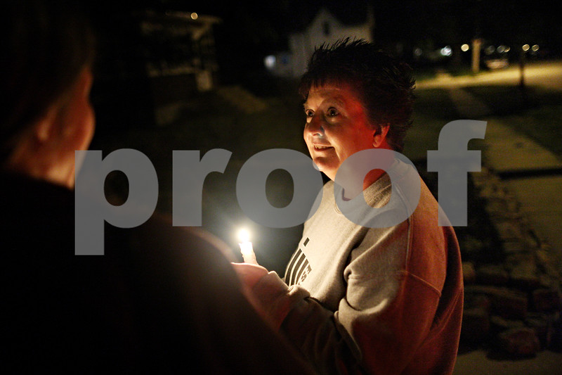 Beck Diefenbach  -  bdiefenbach@daily-chronicle.com<br /> <br /> Anne Petty Johnson, of Davis Junction, Ill., walks during a candle light vigil for Domestic Violence Awareness month held by Safe Passage at the DeKalb Area Women's Center in DeKalb, Ill., on Monday Sept. 5, 2009.