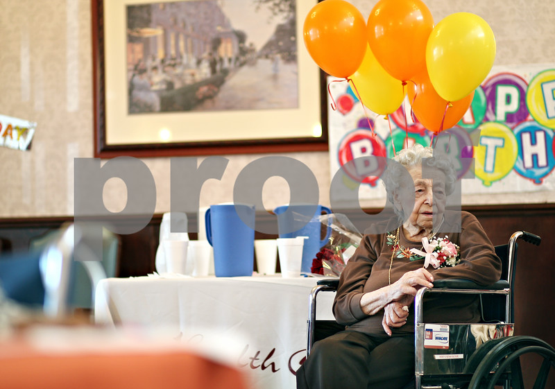 Beck Diefenbach  -  bdiefenbach@daily-chronicle.com<br /> <br /> Ann Schroeter waits for well wishers to come by during her 105th birthday party at Bethany Health Care and Rehab Center in DeKalb, Ill., on Monday Feb. 16, 2009.