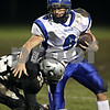 Beck Diefenbach  -  bdiefenbach@daily-chronicle.com<br /> <br /> Geneva quarterback Brandon Beitzel (6)  is taken down by Kaneland linebacker Brock Dyer (32) during the second quarter of the game at Kaneland High School in Maple Park, Ill., on Friday Oct. 16, 2009.