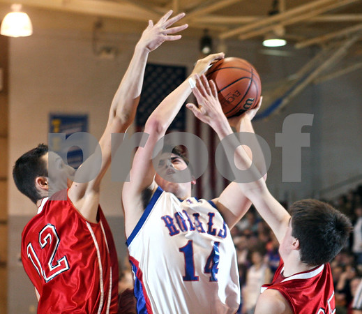 Beck Diefenbach – bdiefenbach@daily-chronicle.com<br /> <br /> Hinckley-Big Rock Ryan Salazar (14) attempts to shoot the ball through the reach of Indian Creek's Mike Wong (12) and Seth Sanderson (25) during the second quarter of the game at H-BR High School in Hinckley, Ill., on Friday Feb. 20, 2009.