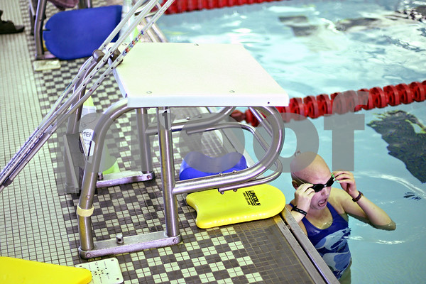 Beck Diefenbach  -  bdiefenbach@daily-chronicle.com<br /> <br /> Grace Waller adjusts her goggle between laps during a swimming practice at the Kishwuakee YMCA in Sycamore, on Wednesday July 15, 2009.