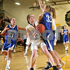Beck Diefenbach  -  bdiefenbach@daily-chronicle.com<br /> <br /> Sycamore guard Kate Binder (21) goes up for a shot against Geneva forward Jeannie Cummings (32) during the second quarter of the game at Sycamore High School in Sycamore, Ill., on Tuesday Feb. 3, 2009. Geneva beat Sycamore 57 to 31.