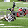 Rob Winner – rwinner@daily-chronicle.com<br /> During the second quarter, Northern's Chad Spann dives into the end zone for the Huskies' third touchdown. Northern Illinois went on to defeat Western Michigan 38-3 on Saturday.<br /> 10/03/2009