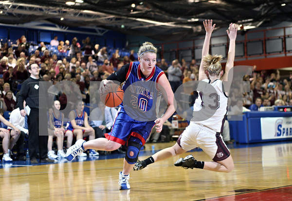 Beck Diefenbach – bdiefenbach@daily-chronicle.com<br /> <br /> Hinckley-Big Rock's Jenna Thorp (20) slips past Dakota's Taylor Borgmann (13) during the fourth quarter of the 1A Super Sectional game at Elgin Community College in Elgin, Ill., on Monday Feb. 23, 2009.