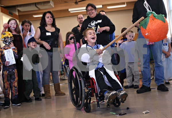 Beck Diefenbach  -  bdiefenbach@daily-chronicle.com<br /> <br /> Ben Martin, 7, of Maple Park, takes a swing at the piñata during the Halloween party at Bethlehem Lutheran Church in DeKalb, Ill., on Saturday Oct. 24, 2009.