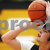 Beck Diefenbach  -  bdiefenbach@daily-chronicle.com<br /> <br /> Sycamore's Harlan Johnson shoots free-throws during practice at Sycamore High School in Sycamore, Ill., on Monday Jan. 19, 2008.