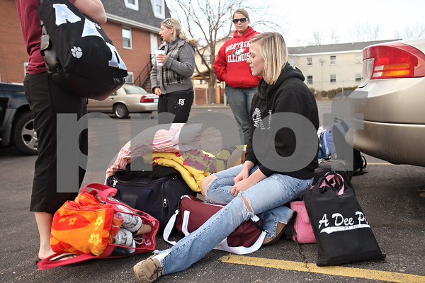 Beck Diefenbach – bdiefenbach@daily-chronicle.com<br /> <br /> Stephanie Osborn, a Northern Illinois University students, waits by her belongings as her Alpha Delta Pi sorority sisters prepare for their road trip to Myrtle Beach, South Carolina, on Friday March 6, 2009.