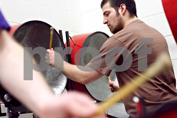 Beck Diefenbach  -  bdiefenbach@daily-chronicle.com<br /> <br /> Northern Illinois University student Kyle Manno plays with the steel band during a rehearsal in the NIU Music Building in DeKalb, Ill., on Tuesday March 17, 2009.