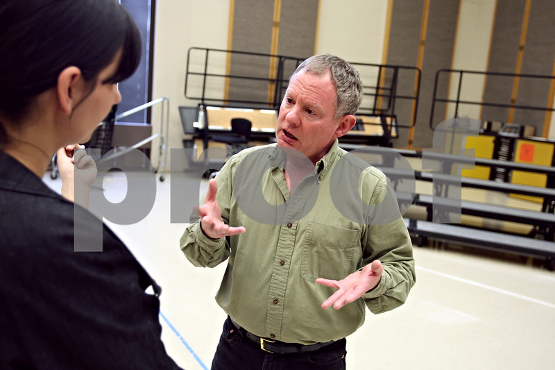 Beck Diefenbach  -  bdiefenbach@daily-chronicle.com<br /> <br /> Northern Illinois University opera workshop director James Tucker (right) confers with conductor Lucia Matos during a rehearsal for an operatic version of Hansel and Gretel in the NIU Music Building in DeKalb, Ill., on Tuesday March 17, 2009.