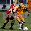 Rob Winner – rwinner@daily-chronicle.com<br /> In the first half, Marian's Tyler Lundquist (left) pressures DeKalb's Joe Ferguson during the IHSA Class 2A Freeport Sectional semifinal in Belvidere on Tuesday October 27, 2009. DeKalb defeated Marian, 1-0.