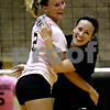 Rob Winner –  rwinner@daily-chronicle.com<br /> DeKalb's Baleigh Euhus (left) hugs teammate Shelby Wood during the second game after a point.<br /> 09/22/2009