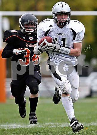 Rob Winner - rwinner@daily-chronicle.com<br /> <br /> DeKalb's Dalton Watie chases after Kaneland's Taylor Callaghan after  hauling in a Camiliere pass just before the first half.<br /> <br /> 10/10/2009