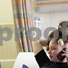 Beck Diefenbach  -  bdiefenbach@daily-chronicle.com<br /> <br /> Grace Waller chats on the phone with a friend while in observation following another round of chemotherapy at Rush Medical Hospital in Chicago on Saturday July 18, 2009. Waller's Blackberry and laptop are in constant use as they provide her a substantial connection to the outside world.