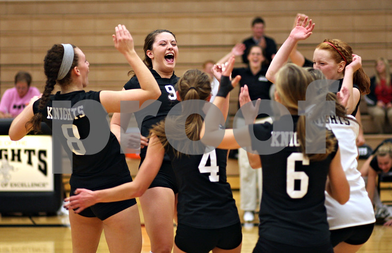 Beck Diefenbach – bdiefenbach@daily-chronicle.com<br /> <br /> Kaneland's Jessica Lubic (9) celebrates with her team after defeating DeKalb High School at Kaneland High School in Maple Park, Ill., on Saturday Sept. 19, 2009.